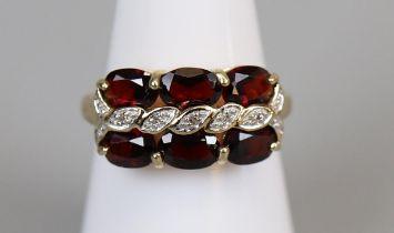 Gold garnet & diamond set ring (size M½)