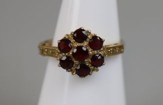 Gold red stone set ring (size L)