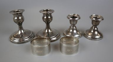4 hallmarked silver candlesticks & 2 hallmarked silver napkin rings