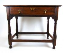 An 18th century and later oak side table, the moulded top over a single drawer on turned legs, h.
