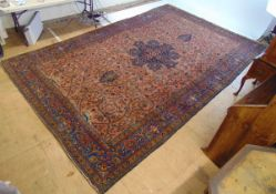 A large handwoven Persian rug,