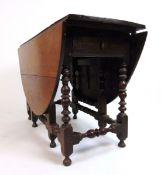 A late 17th / early 18th century walnut gateleg table,