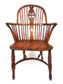 An early 19th century and later yew, elm and beech Windsor chair,
