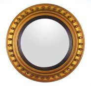 A Regency gilt wood convex mirror,