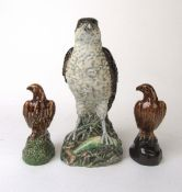 A Beswick Peter Thompson Osprey whisky bottle together with two miniature Beswick whisky bottles