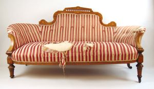 An Edwardian walnut, amboyna, boxwood strung and marquetry settee,