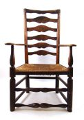 An early 19th century ash open armchair,