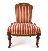 An Edwardian walnut, amboyna, boxwood strung and marquetry nursing chair,