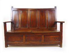 A mid 18th century oak settle,