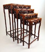 A late 19th/ early 20th century Chinese padouk quartetto nest of tables,