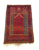 A handwoven Turkish prayer rug, the triple line border enclosing the red ground niche,