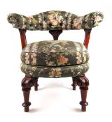 A Victorian walnut swivel chair upholstered in a floral pattern fabric,