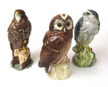 A Beswick a Tawny Owl whisky bottle together with a Buzzard and Merlin CONDITION REPORT:
