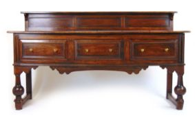 A reproduction 18th century style oak sideboard,