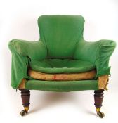 A 19th century Howard and son's style armchair on turned mahogany front legs with Cope's patent