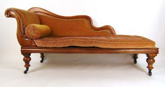A Victorian mahogany chaise longue upholstered in a cut peach/gold fabric on turned legs, h.