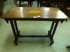 A Victorian mahogany inlaid hall table with bobbin supports