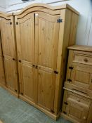 A pine two door arch topped wardrobe