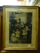 A gilt framed and glazed etching of mother and children titled 'This first Christmas' from the