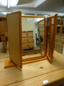 A pine framed triple vanity mirror