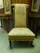 A Victorian rosewood prayer chair with barley twist supports to back upholstered in a cut fabric