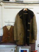 A Wareing leather waist coat along with a sheepskin jacket