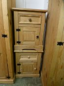 A pair of stripped pine bedside cabinets