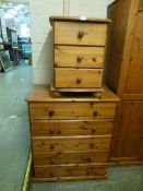 A modern pine chest of five long drawers along with a bedside chest of three drawers