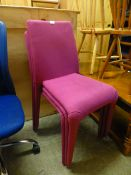 A set of three cerise upholstered chairs