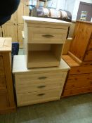 A sycamore effect chest of three long drawers along with a matching bedside cabinet