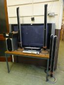 An LG flat screen TV along with a LG DVD player, surround sound speakers etc.