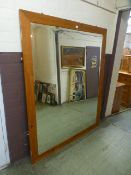 A substantial pine framed beveled glass mirror,