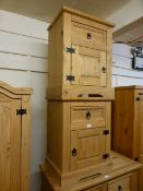 A pair of stripped pine bedside cabinets,