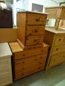 A pine chest of four long drawers along with a pine bedside chest
