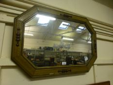 A reproduction wood effect wall mirror