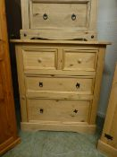 A stripped pine chest of two short over two long drawers
