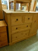 A pine chest of two short over two long drawers