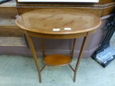 An Edwardian fiddle back mahogany topped and boxwood strung occasional table with under tier