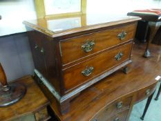 A Georgian style mahogany chest of two drawers on bracket feet