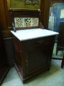 An Edwardian marble topped walnut washstand,