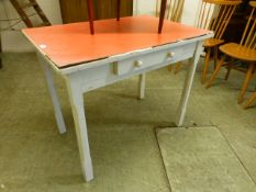 A red Formica topped single drawer table with white base