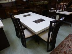 An Italian style marble dining table with contrasting marbles along with a set of six stained ash