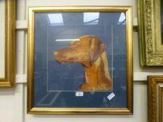 A framed and glazed pastel of a dog