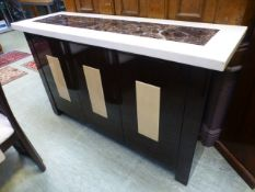 An Italian style marble topped three door sideboard