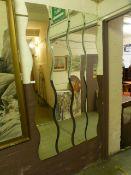 Four wavy edge mirrors