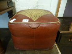 A red leather pouffe