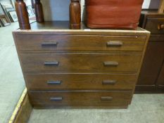 A mid 20th century oak chest of four long drawers