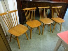 A set of four beech and ply kitchen chairs