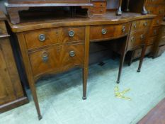 A George III mahogany and boxwood strung serpentine front sideboard,