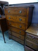 An early 20th century oak chest of six drawers